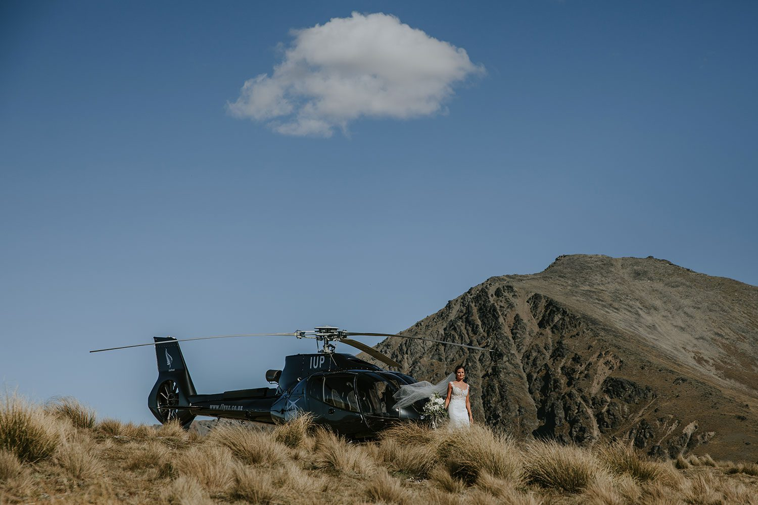 Ashleigh and Michael - helicopter on hill
