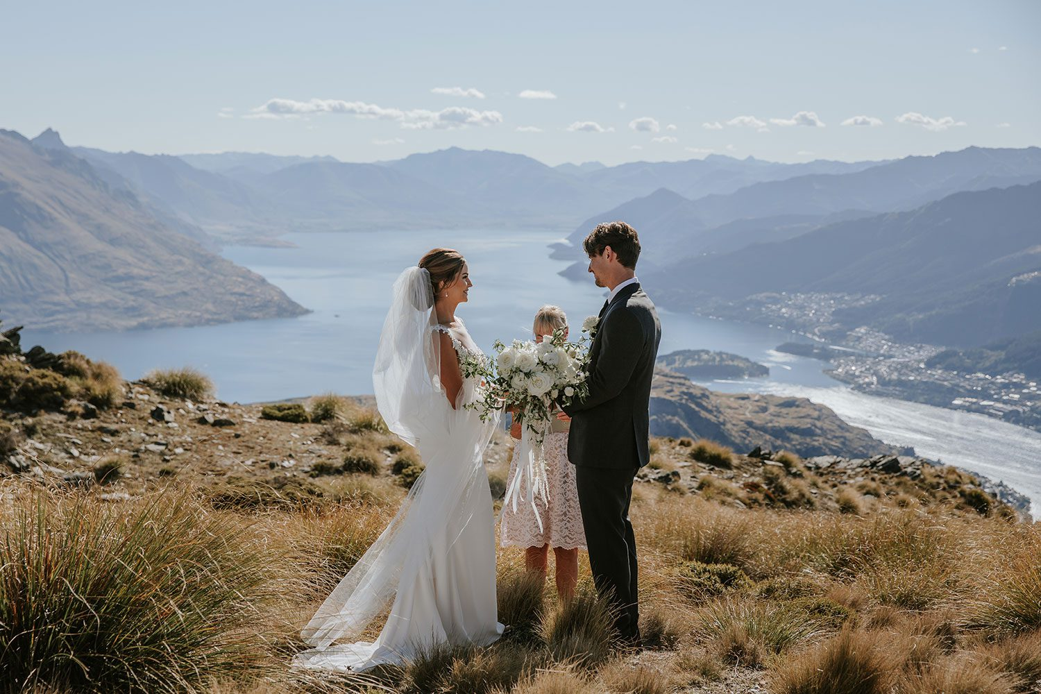 Bride wearing bespoke bridal gown with richly beaded lace over sheer tulle bodice and low back from Auckland wedding dress designer Vinka designs - saying vows