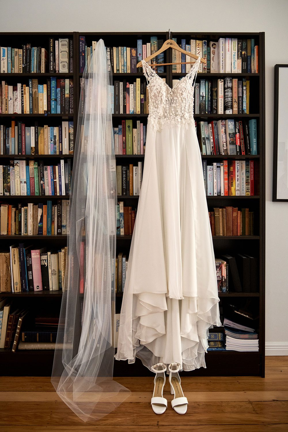 Bespoke gown made of silk chiffon with delicate flower lace bodice by Vinka bridal designer Auckland - hanging with veil