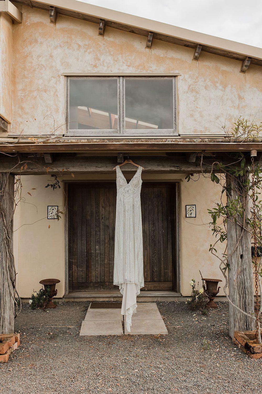 Rachel and Leon - dress hanging outside